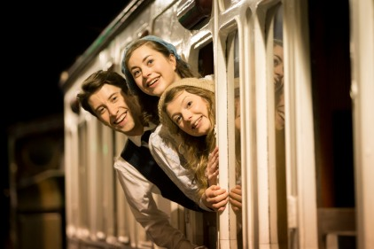Matt Jessup as Peter, Sophie Ablett as Bobbie and Beth Lilly as Phyllis in The Railway Children. Credit Johan Persson.